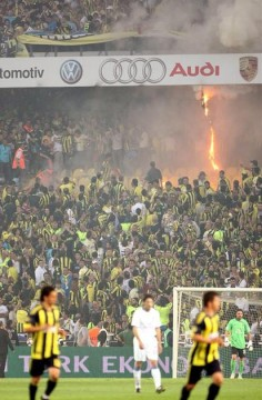 Fans start fires in sections of the Fenerbahce Sukru Saracoglu Stadium.