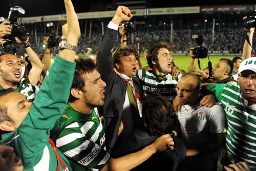 Bursaspor manager, Ertugrul Saglam celebrates the championship received after winning his former club where he served for years as a player and a manager