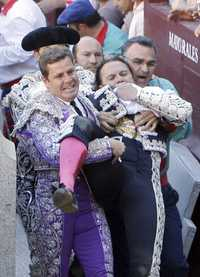 matador being carried after horrific injury