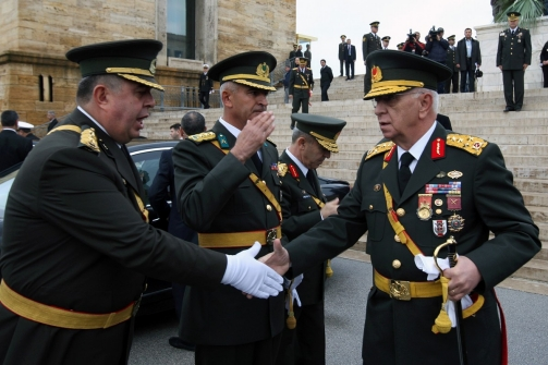 Turkey's Chief of Staff Gen. Isik Kosaner, right, shakes hands with his officers during a ceremony marking the 87th anniversary of the Turkish Republic at the mausoleum of Mustafa Kemal Ataturk, founder of modern Turkey, in Ankara, Turkey