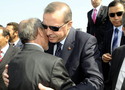 Turkish Prime Minister Recep Tayyip Erdoğan (R) is greeted warmly by Mustafa Abdel Jalil upon his arrival at Tripoli.