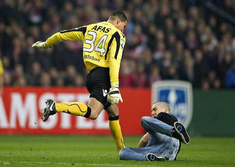 Az Alkmaar Goalkeeper Esteban kicking the ball...of his attacker