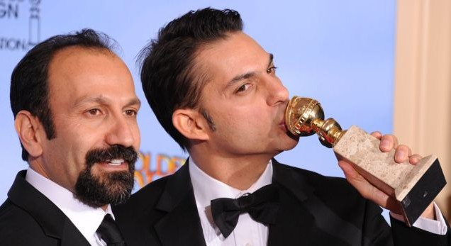Director Asghar Farhadi (left) and actor and screenwriter Peyman Moaadi pose with their Golden Globe for best foreign language film