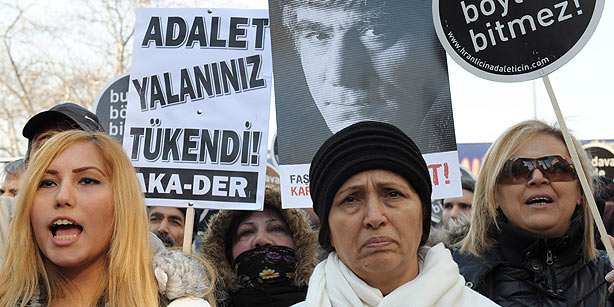 Rakel Dink, wife of Hrant Dink (C) joins hundreds of people as they shout slogans and hold placards that read 'This case won't end this way' outside a courthouse in İstanbul on Jan. 17, 2012