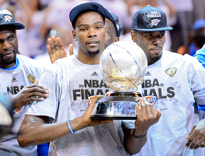 Thunder Durant celebrates with the trophy after edging the San Antonio Spurs to win the Western Conference Finals of the 2012 NBA Playoffs 