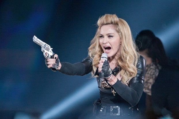 National Front sues Madonna over Le Pen swastika shown at the concert in Paris