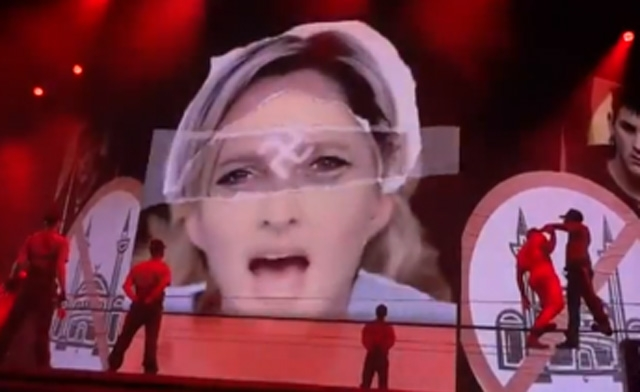 Marine Le Pen with a swastika superimposed on her face at a concert in Paris.