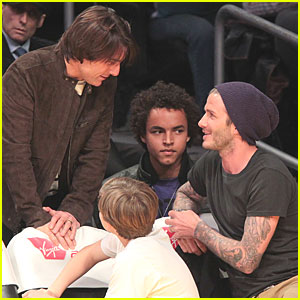 Tom Cruise and david Beckham sharing time together at a Lakers game