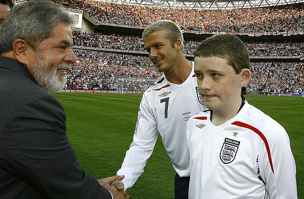 England mascot Sebbage watching as Brazil's President Lula da Silva greets England's Beckham before friendly match against Brazil in London, David Beckham