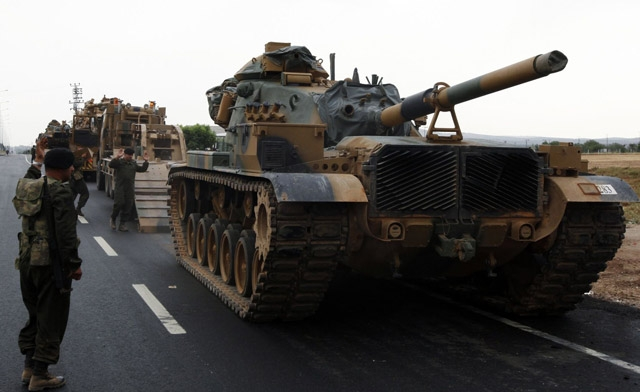 Turkey piles convoys carrying troops, missile batteries and armored vehicles to Syrian border