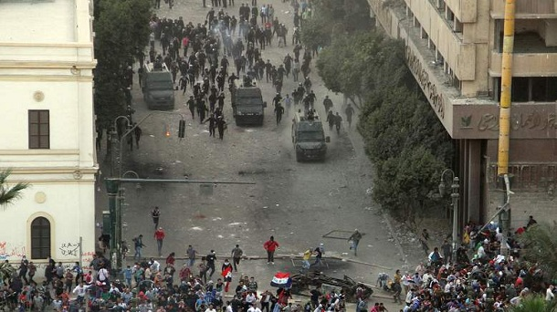 Egyptian anti-riot police clash with protesters demonstrating against Egypt's Islamist President Mohamed Morsi in Cairo's landmark Tahrir square on November 23, 2012. Morsi has assumed temporary sweeping powers that supporters say will cut back a turbulent and seemingly endless transition to democracy, but outraged critics say he has now become a dictator.