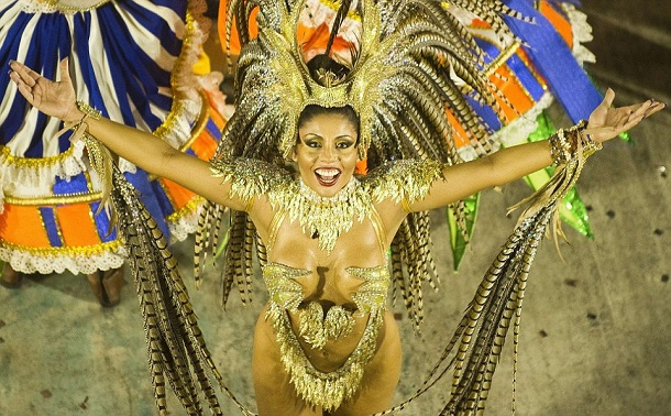 A reveler of Portela samba school performs during the first night of Carnival parade at the Sambadrome in Rio de Janeiro, Brazil on February 11, 2013.