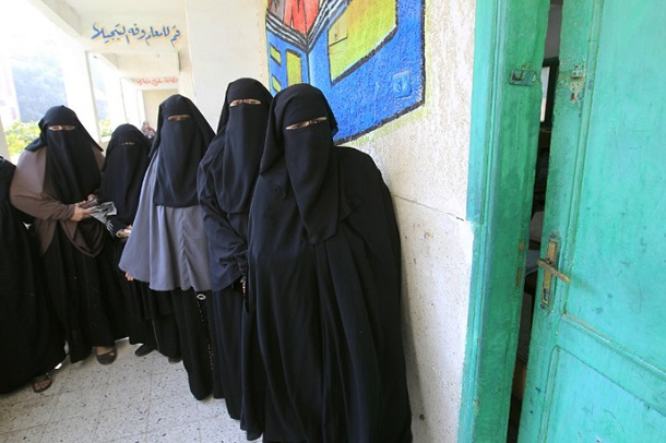 Niqab-clad Egyptian women line up to vote at a polling station in Qaliubia, some 40 kms north of Cairo, on January 4, 2012 as Egyptians headed to the polls again in the final round of a phased election to choose the first parliament since a popular uprising toppled Hosni Mubarak in February.