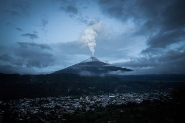 Smoke spews from Popocatepetl near Santiago Xalitzintla twilight