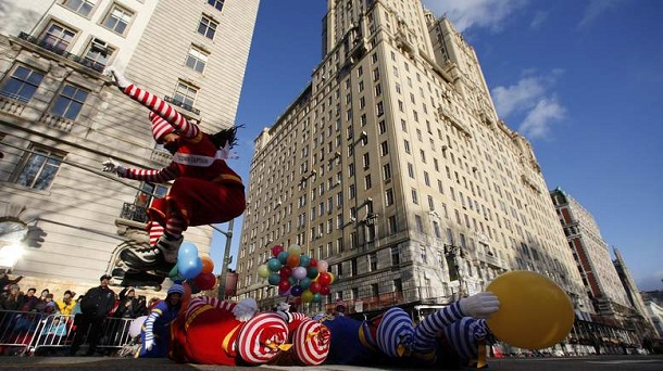 Clown Martin Thomas leaps over fellow clowns before the start of the 87th Macy's Thanksgiving Day Parade in New York