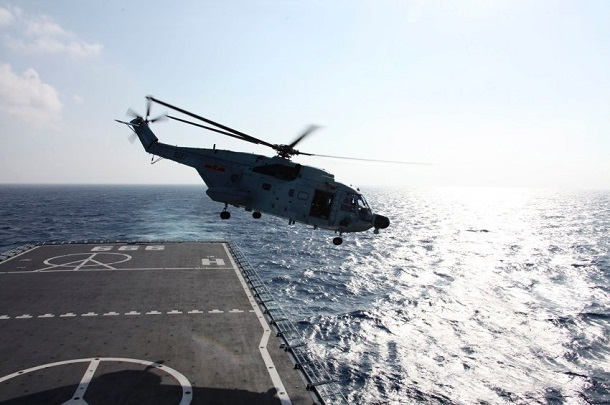 A helicopter takes off from Jinggangshan warship to search the waters suspected to be the site of the missing Beijing-bound Malaysia Airlines flight MH370