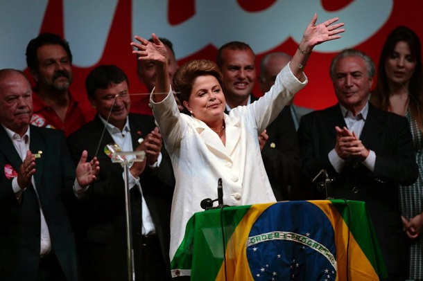 Brazil's President and Workers' Party presidential candidate Rousseff celebrates after disclosure of the election results, in Brasilia