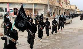 ISIS militants marching with flags. File Pic